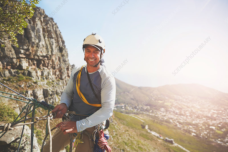 Portrait smiling, confident rock climber