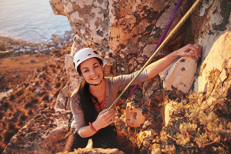 Portrait smiling, confident female rock climber