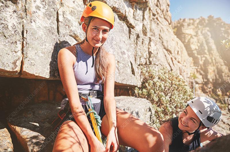 Portrait smiling, confident female rock climbers