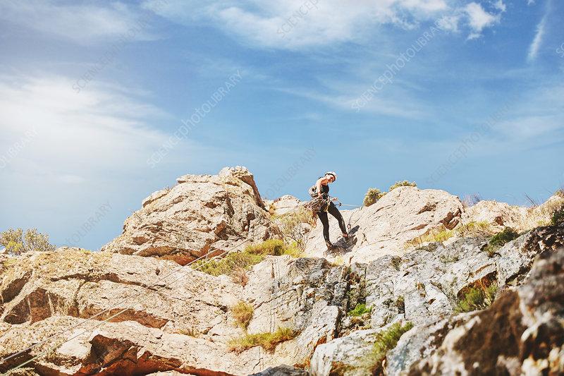 Rock climber climbing rocks