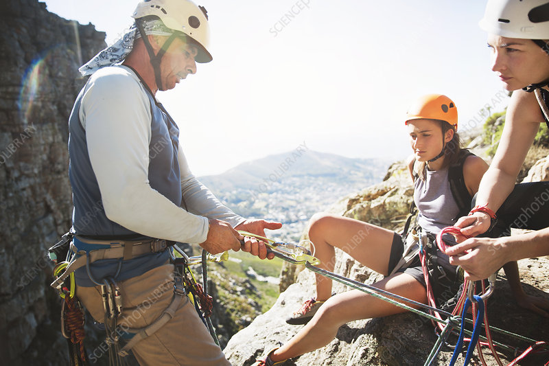 Rock climbers preparing equipment