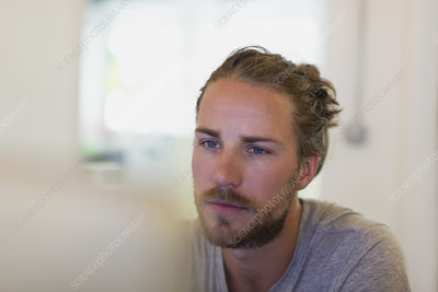 Focused creative businessman working at laptop