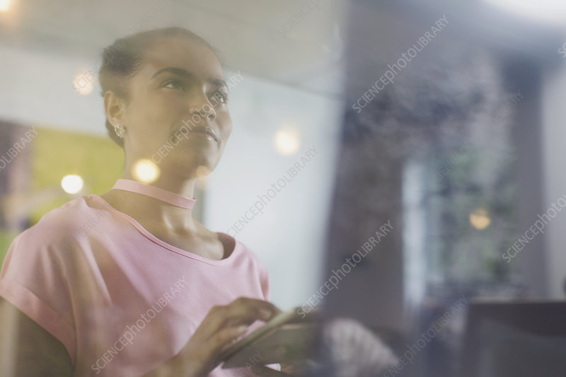 Ambitious businesswoman using digital tablet