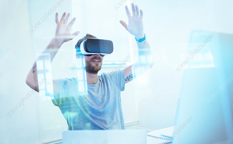 Male computer programmer testing VR glasses