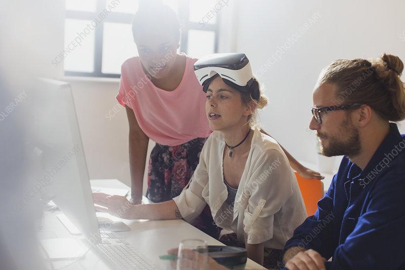 Computer programmers programming VR glasses