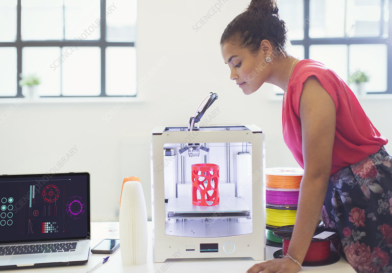 Female designer watching 3D printer