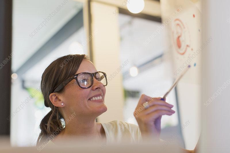 Smiling designer examining transparency diagram