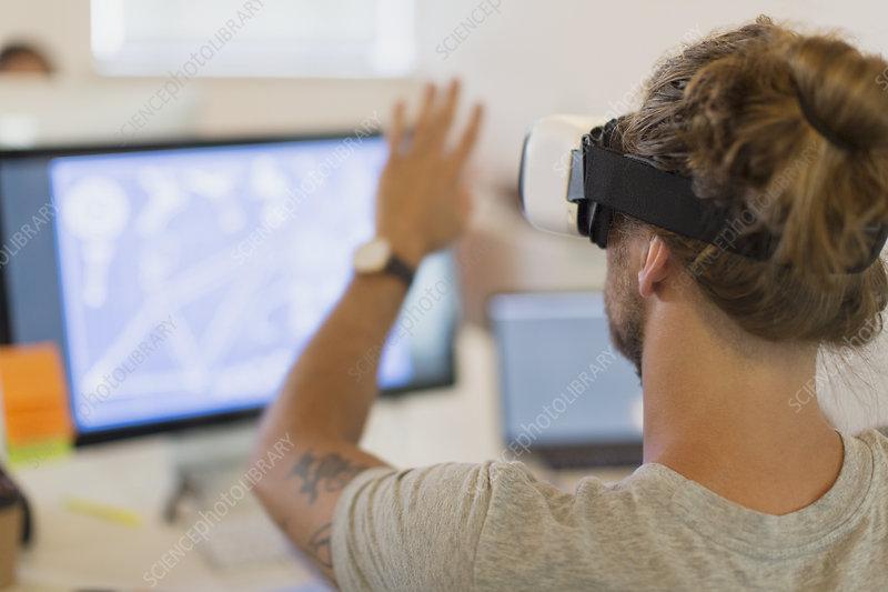 Computer programmer testing VR glasses