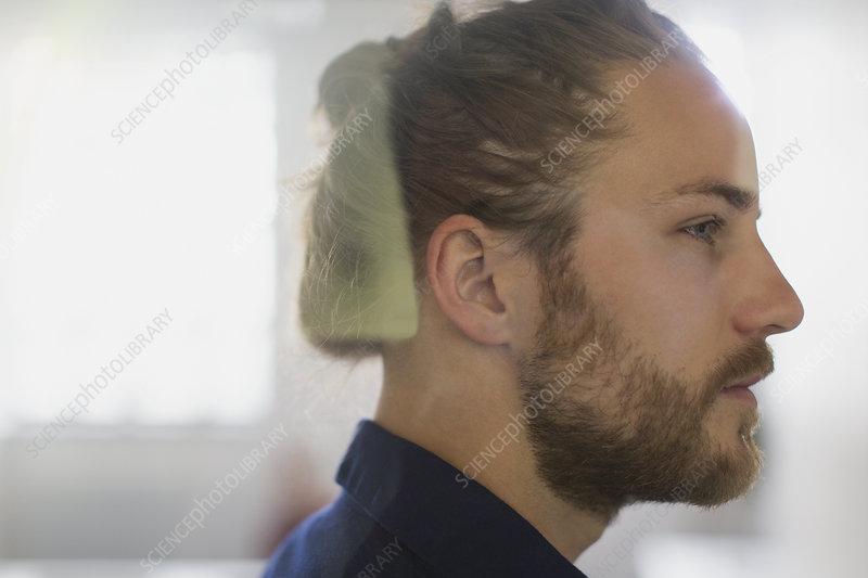 Profile thoughtful man with beard
