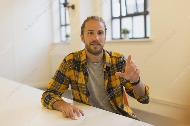 Portrait creative businessman using computer