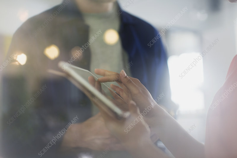 Close up businesswoman using digital tablet