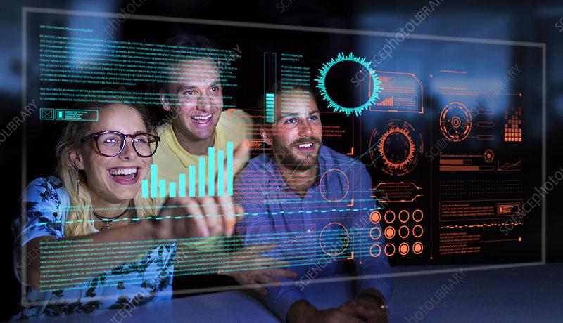 Business people using futuristic hologram computer