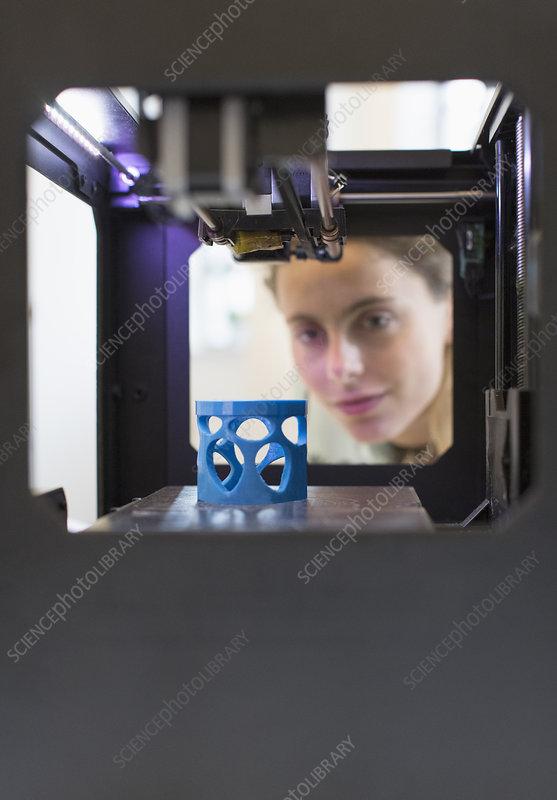 Female designer using 3D printer
