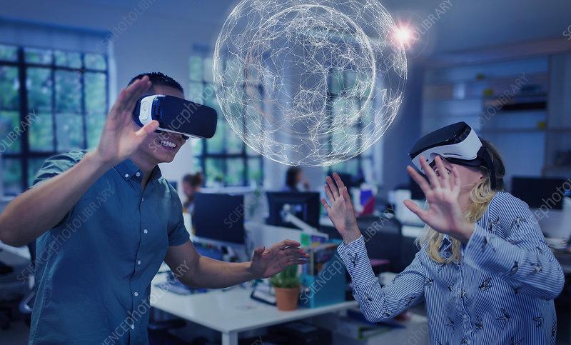 Computer programmers testing VR glasses