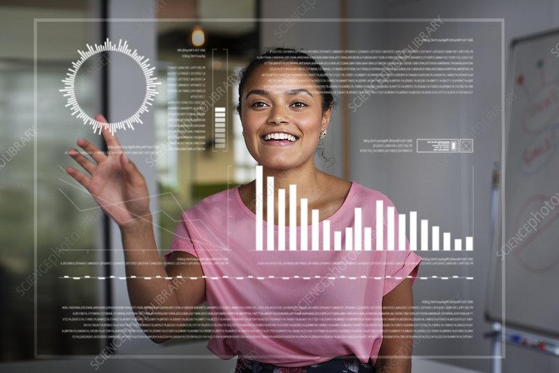 Businesswoman using futuristic hologram computer