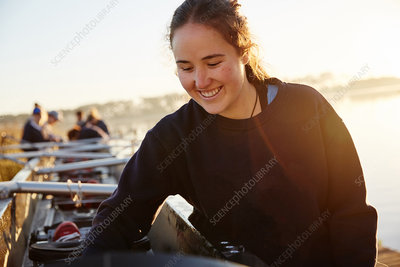 Smiling female rower preparing scull