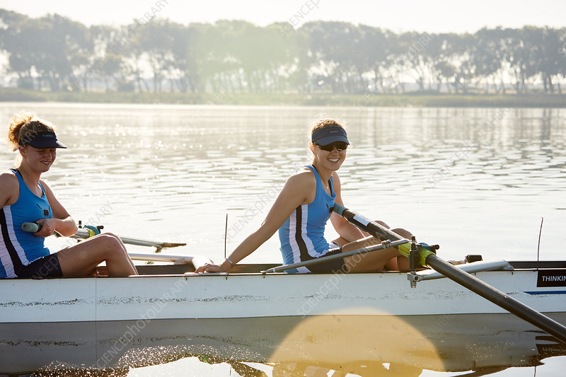 Portrait smiling rower in scull