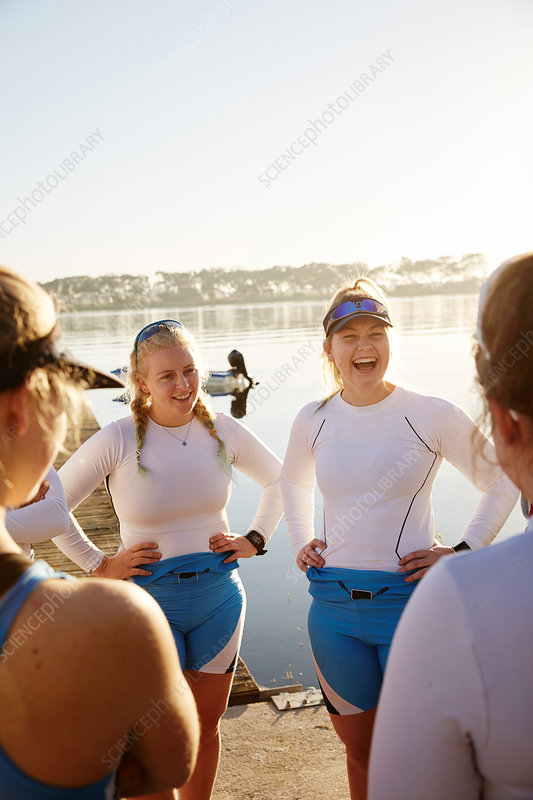 Female rowing team laughing and talking