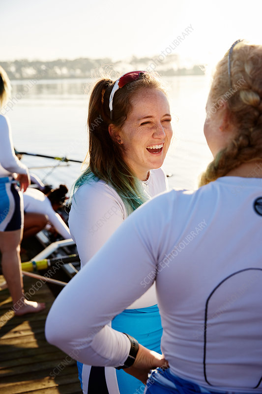 Female rowers smiling and talking