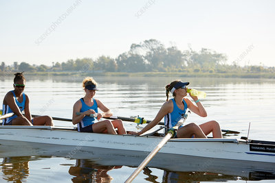 Female rowing team resting