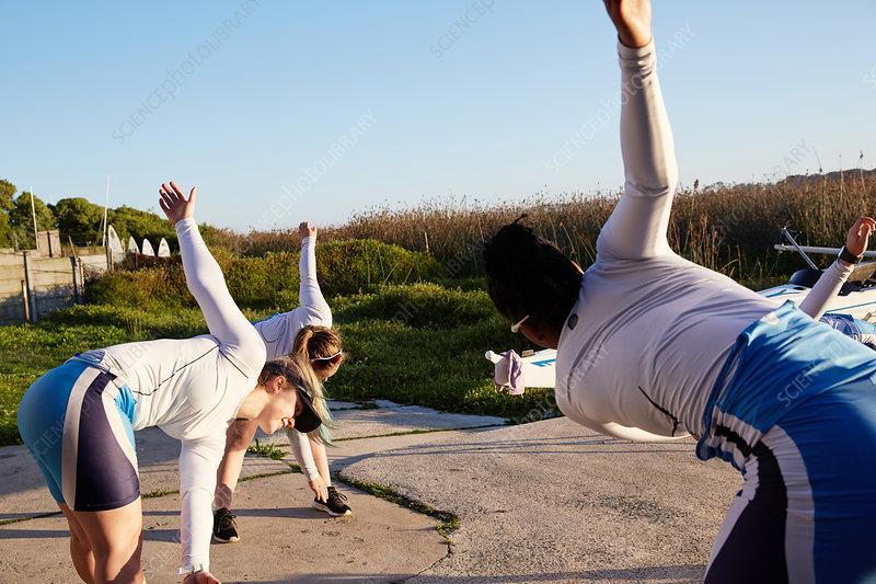 Female rowers stretching, preparing