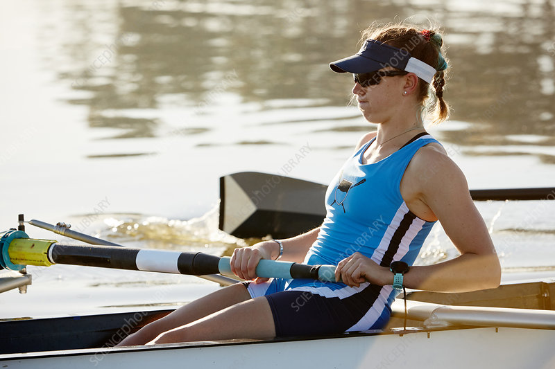 Determined female rower rowing scull