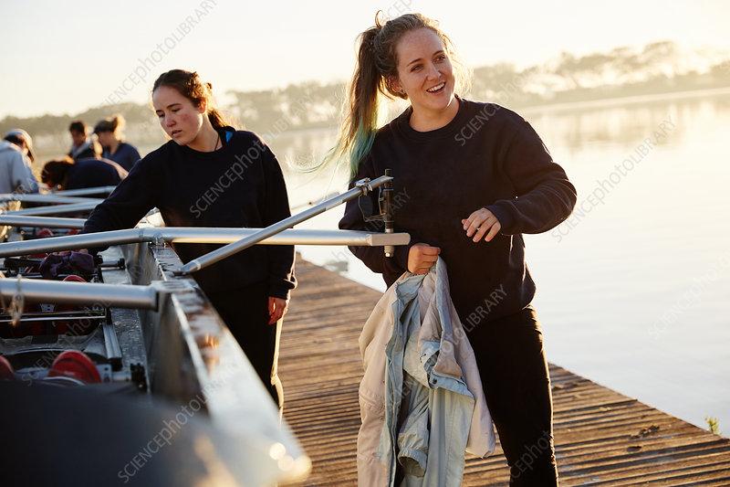 Smiling rower preparing scullside dock