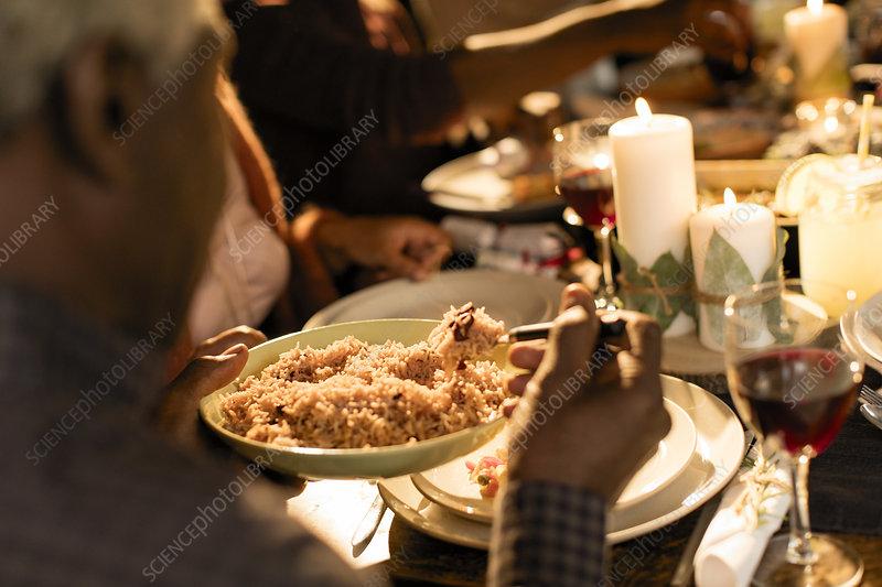 Family enjoying Christmas dinner, serving food