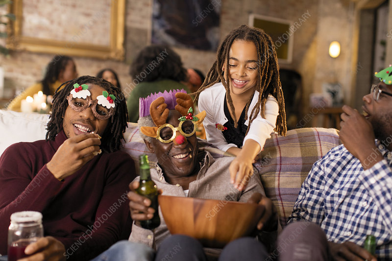 Playful family wearing Christmas glasses