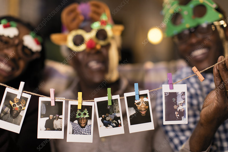 Family in goggles showing instant photos