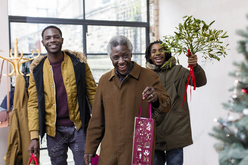 Grandfather and grandsons with Christmas gift