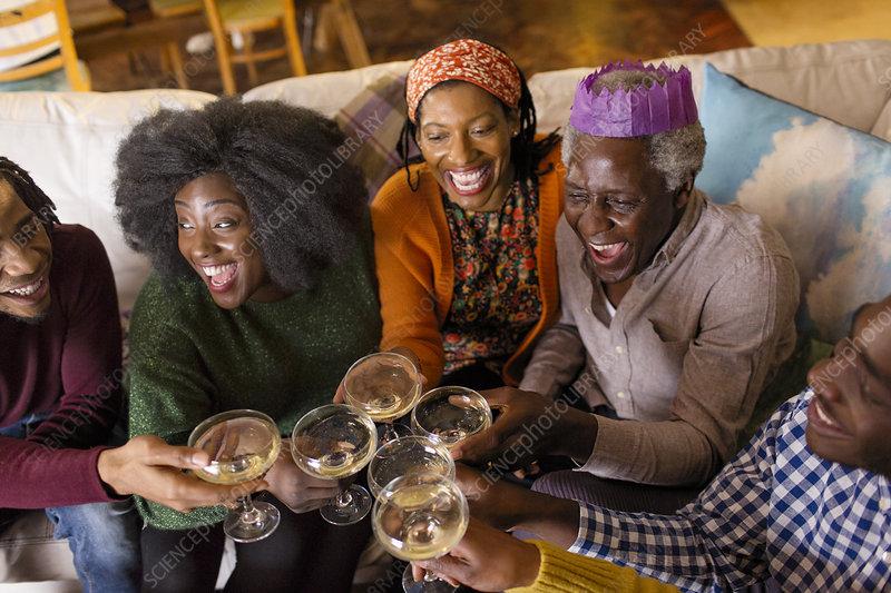 Family toasting champagne, celebrating Christmas