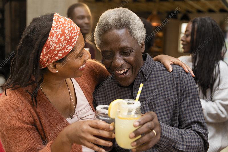 Senior father and daughter toasting lemonade