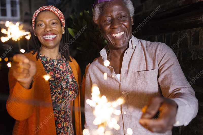 Father and daughter celebrating with sparklers