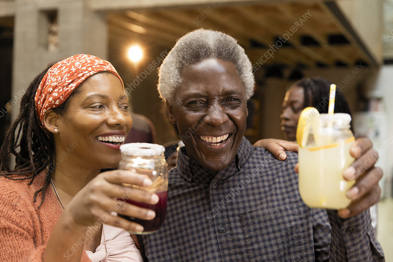 Father and daughter drinking lemonade and sangria