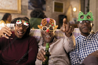 Family wearing Christmas costume goggles