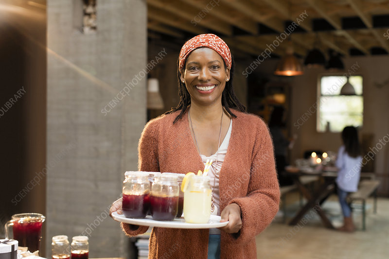 Portrait woman serving lemonade and sangria