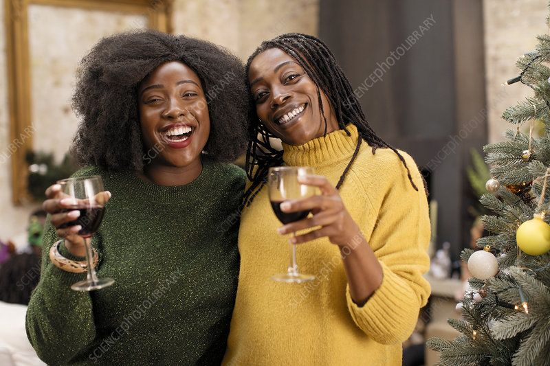 Mother and daughter drinking wine