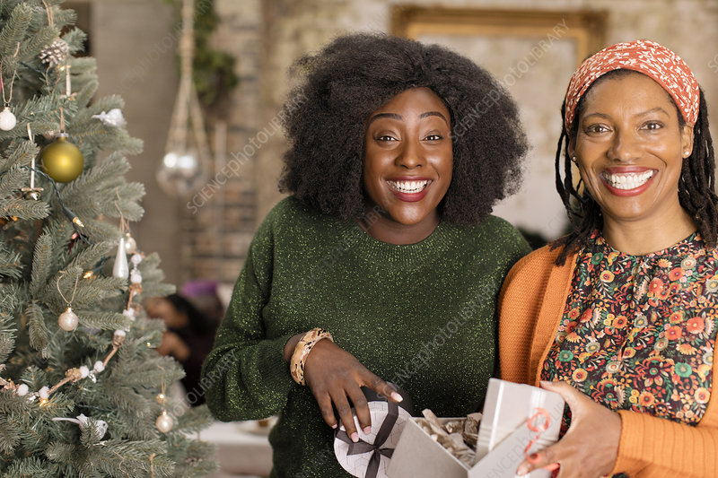 Mother and daughter opening Christmas gift