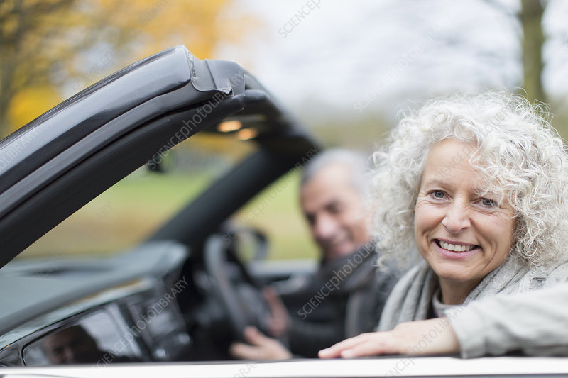 Portrait smiling senior couple in convertible