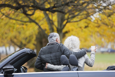 Senior couple with convertible at autumn park