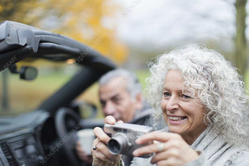 Smiling senior couple in convertible