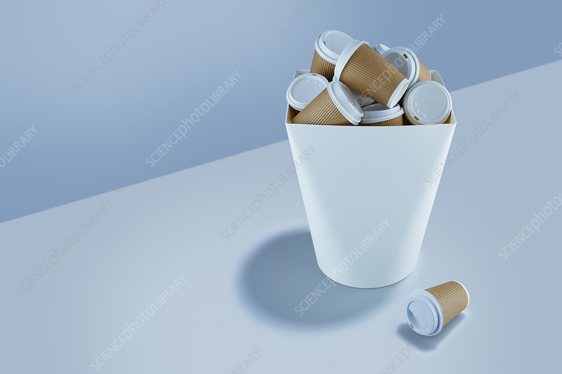 Recyclable coffee cups stacked in garbage can