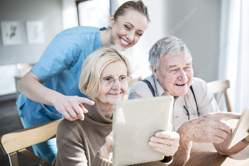 Senior couple using tablets