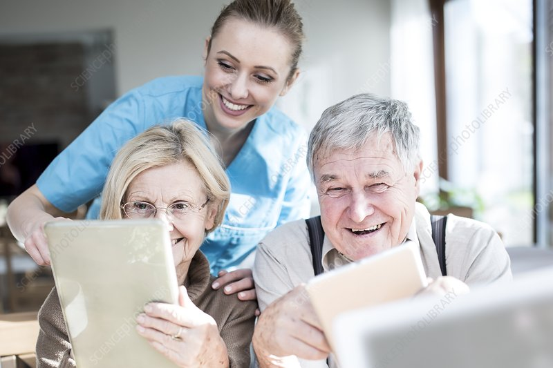 Senior couple using tablets