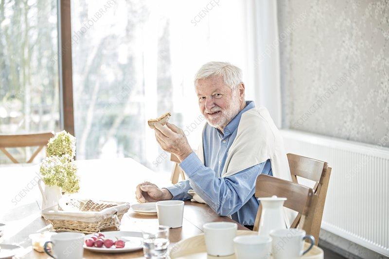 Senior man eating meal