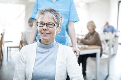 Senior women smiling towards camera