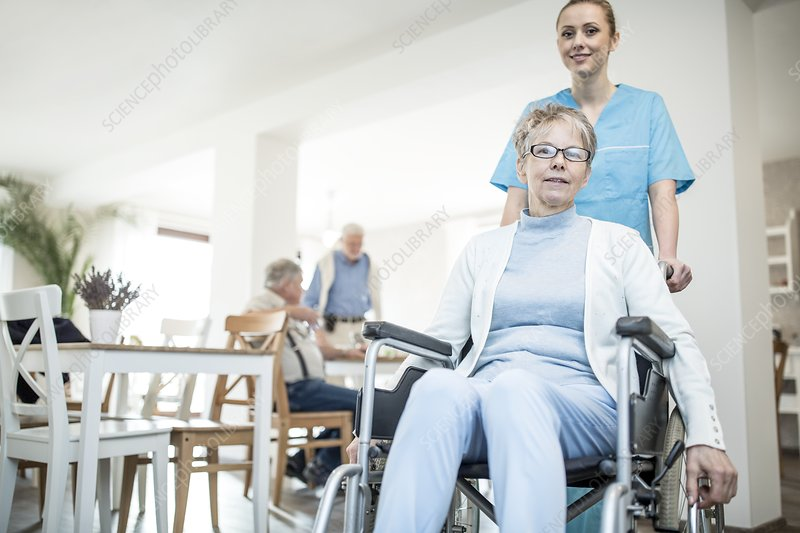 Woman in wheelchair with carer