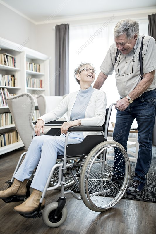 Woman in wheelchair with man