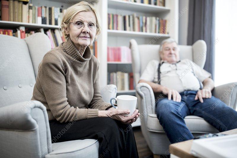 Senior couple sitting on armchairs